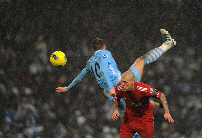 Liverpool vs Manchester City Martin Skrtel vies for the ball against Edin Dzeko